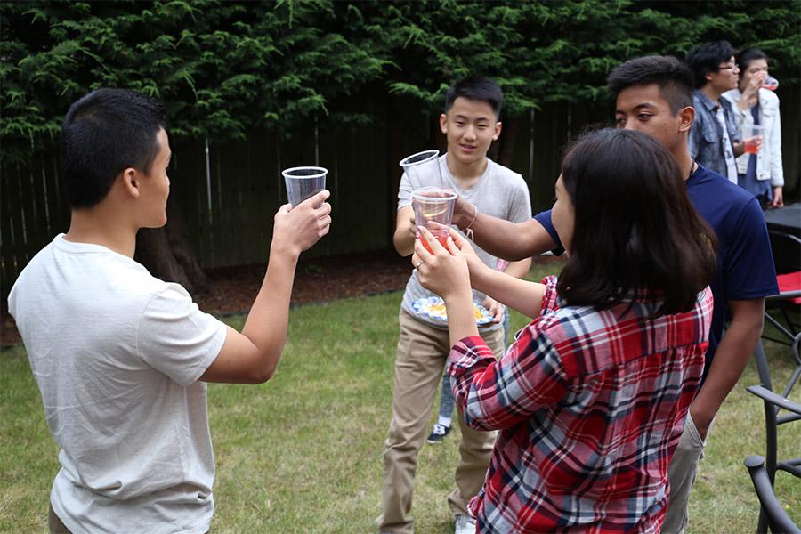 Graduates and families toast