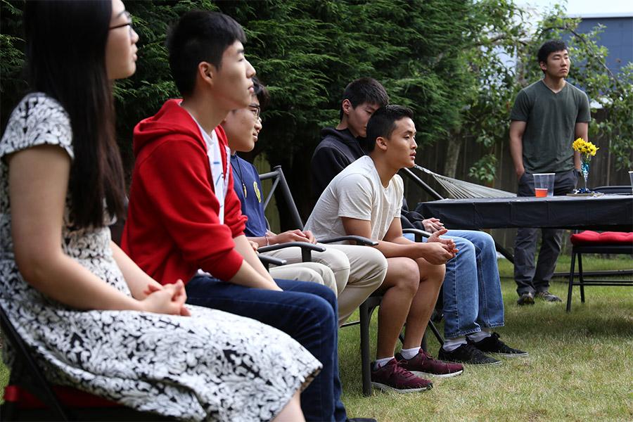 Graduates listen to parents' congratulatory remarks